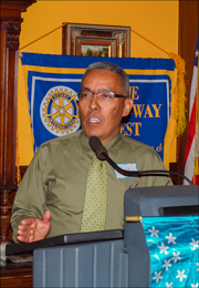 Photo of Joel Reyes speaking at Rotary Club