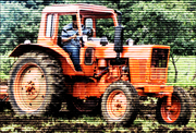 An photo of a tractor working the fields