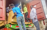 photo showing ICC Congo staffers unloading the container shipped from Prolasa Canada to the DR Congo