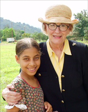 An photo of Alice Shultz with a child from the Las Palmas Children's Village