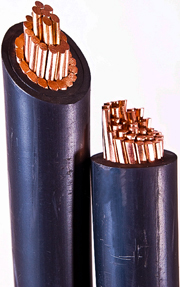A photo showing the type of rubber-coated, heavy-duty copper cable used for powerlines that transfer electricity to your home. The cable has be cut in half exposing the copper wire that makes up the core of the cable