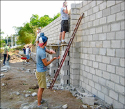 A photo of some of the members of the CAA/Vancouver SDA mission group building their part of the cinder block wall which will eventually enclose the campus while volunteering at the ICC project in El Salvador