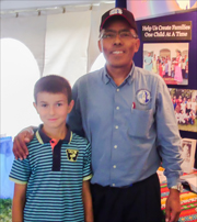 Photo of Joel Reyes and a young supporter of ICC