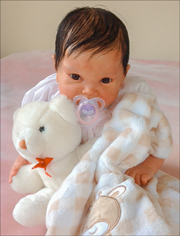 photo of a life-like infant doll