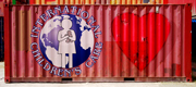 photo illustration of a red shipping container with the ICC logo and a giant heart painted on the side