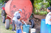 A photo of the Fuente de Vida water being distributed from the mobile water tank